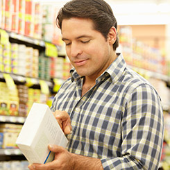 Man looking at ingredients in grocery store.