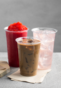 Three drinks including iced coffee, smoothie and flavored water