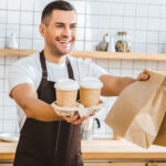 Man in Restaurant Serving Behind Counter